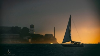 Sailboat passing in front of Alcatraz